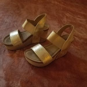 Wedge gold sandals 6 look new.